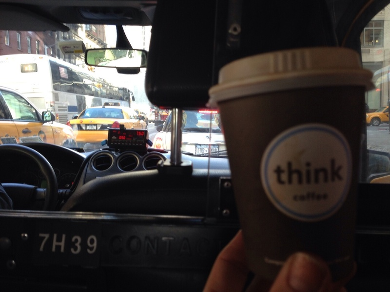 look like a local / coffee to go in de taxi in New York City