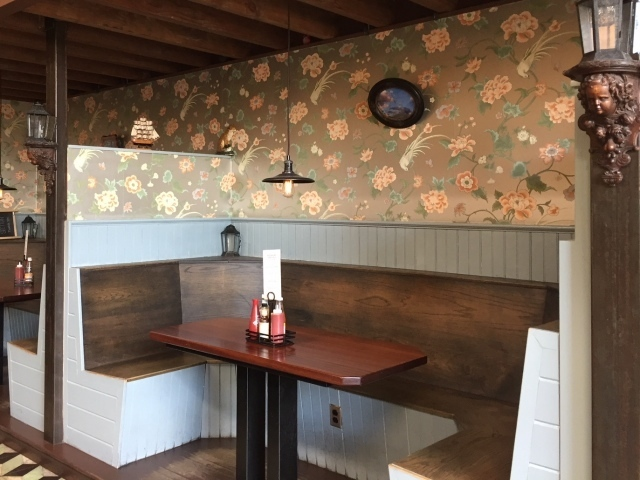 Flower wallpaper covers the booths at the Rookery in Bushwick Brooklyn